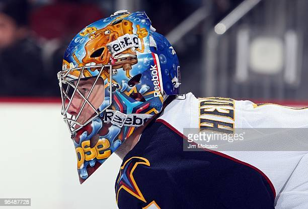 Johan Hedberg of the Atlanta Thrashers looks on against the New Jersey Devils at the Prudential Center on December 28 2009 in Newark New Jersey