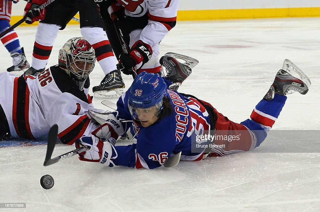 <a gi-track='captionPersonalityLinkClicked' href=/galleries/search?phrase=Johan+Hedberg&family=editorial&specificpeople=202078 ng-click='$event.stopPropagation()'>Johan Hedberg</a> #1 of the New Jersey Devils defends against <a gi-track='captionPersonalityLinkClicked' href=/galleries/search?phrase=Mats+Zuccarello&family=editorial&specificpeople=7219903 ng-click='$event.stopPropagation()'>Mats Zuccarello</a> #36 of the New York Rangers at Madison Square Garden on April 27, 2013 in New York City.