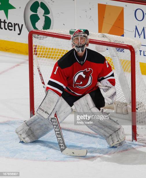 Johan Hedberg of the New Jersey Devils defends his net against the Pittsburgh Penguins at the Prudential Center on April 25 2013 in Newark New Jersey