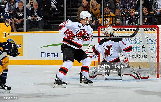 Johan Hedberg of the New Jersey Devils gives up a goal to Colin Wilson of the Nashville Predators at the Bridgestone Arena on October 15 2011 in...
