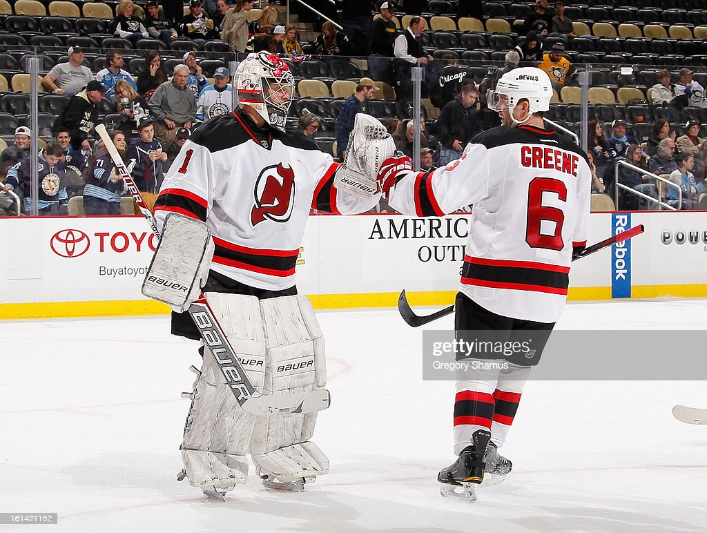 Johan Hedberg #1 of the New Jersey Devils is congratulated by Andy Greene #6 after a 3-1 win over the Pittsburgh Penguins on February 10, 2013 at Consol Energy Center in Pittsburgh, Pennsylvania.