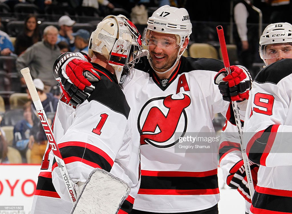Johan Hedberg #1 of the New Jersey Devils is congratulated by Ilya Kovalchuk #17 after a 3-1 win over the Pittsburgh Penguins on February 10, 2013 at Consol Energy Center in Pittsburgh, Pennsylvania.