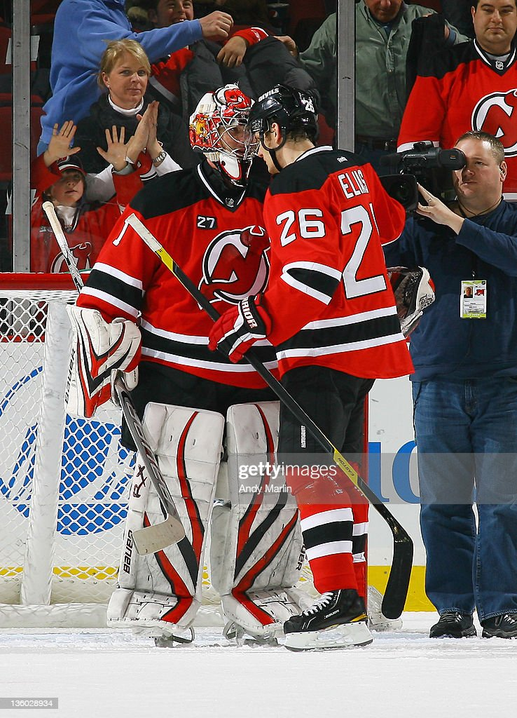 <a gi-track='captionPersonalityLinkClicked' href=/galleries/search?phrase=Johan+Hedberg&family=editorial&specificpeople=202078 ng-click='$event.stopPropagation()'>Johan Hedberg</a> #1 of the New Jersey Devils is congratulated by teammate <a gi-track='captionPersonalityLinkClicked' href=/galleries/search?phrase=Patrik+Elias&family=editorial&specificpeople=201827 ng-click='$event.stopPropagation()'>Patrik Elias</a> #26 after defeating the Dallas Stars during the game at the Prudential Center on December 16, 2011 in Newark, New Jersey. Devils defeat Stars 6 -3.