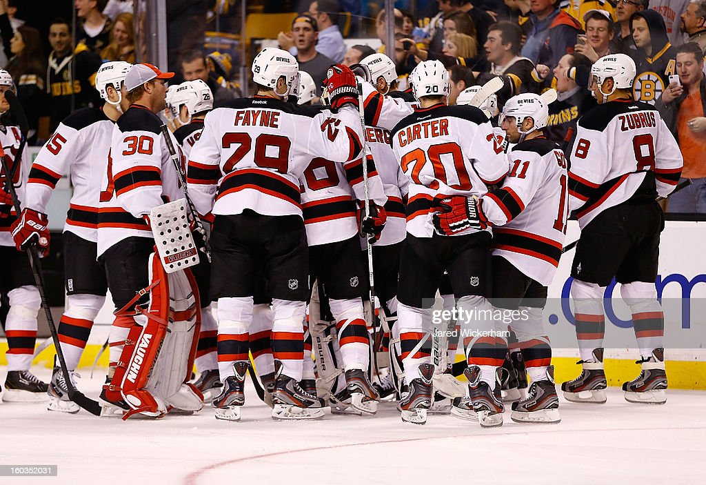Johan Hedberg #1 of the New Jersey Devils is surrounded by teammates following a shootout loss to the Boston Bruins during the game on January 29, 2013 at TD Garden in Boston, Massachusetts.