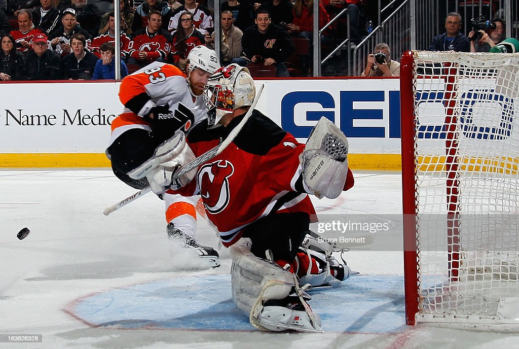 Johan Hedberg #1 of the New Jersey Devils kicks out a shot by Jakub Voracek #93 of the Philadelphia Flyers during the first period at the Prudential Center on March 13, 2013 in Newark, New Jersey.