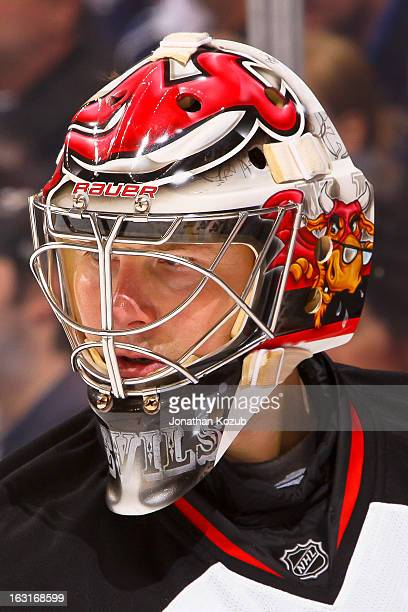 Johan Hedberg of the New Jersey Devils looks on during a thirdperiod stoppage in play against the Winnipeg Jets at the MTS Centre on February 28 2013...