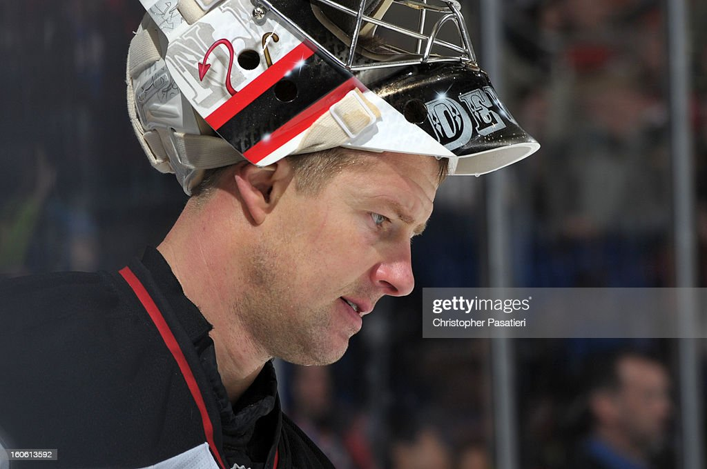 Johan Hedberg #1 of the New Jersey Devils looks on during the game against the New York Islanders on February 3, 2013 at Nassau Veterans Memorial Coliseum in Uniondale, New York.