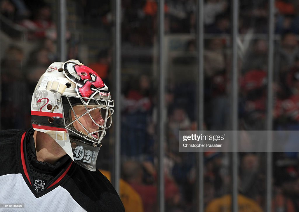 Johan Hedberg #1 of the New Jersey Devils looks on during the game against the New York Islanders on February 16, 2013 at Nassau Veterans Memorial Coliseum in Uniondale, New York.
