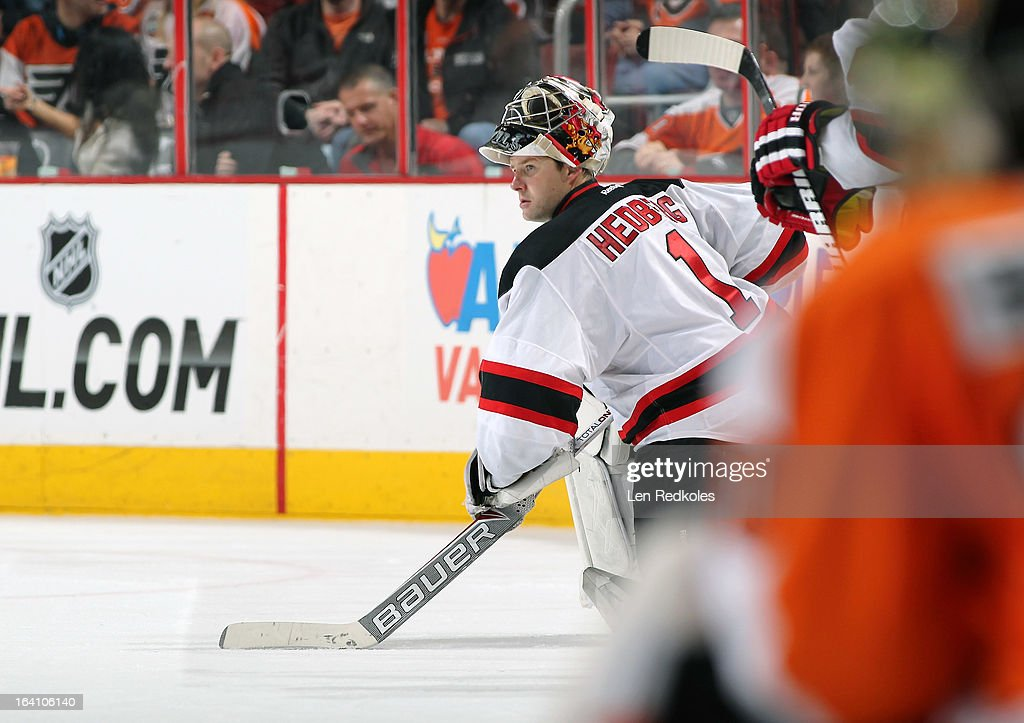 Johan Hedberg #1 of the New Jersey Devils looks on prior to a shootout against the Philadelphia Flyers on March 15, 2013 at the Wells Fargo Center in Philadelphia, Pennsylvania.