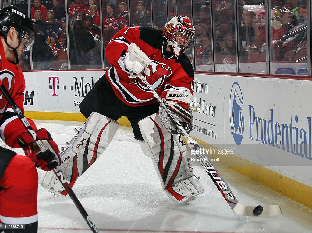 <a gi-track='captionPersonalityLinkClicked' href=/galleries/search?phrase=Johan+Hedberg&family=editorial&specificpeople=202078 ng-click='$event.stopPropagation()'>Johan Hedberg</a> #1 of the New Jersey Devils looks to clear the puck against the New York Islanders at the Prudential Center on April 3, 2012 in Newark, New Jersey. The Devils defeated the Islanders 3-1.