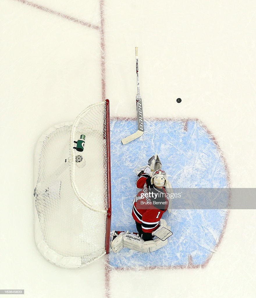 <a gi-track='captionPersonalityLinkClicked' href=/galleries/search?phrase=Johan+Hedberg&family=editorial&specificpeople=202078 ng-click='$event.stopPropagation()'>Johan Hedberg</a> #1 of the New Jersey Devils loses his stick and a shot by the Montreal Canadiens hits it and bounces away at the Prudential Center on March 16, 2013 in Newark, New Jersey. The Canadiens defeated the Devils 2-1.