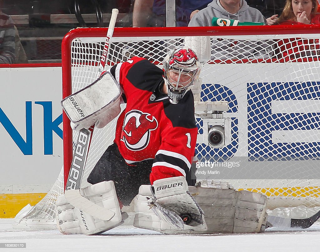 Johan Hedberg #1 of the New Jersey Devils makes a glove save against the Philadelphia Flyers during the game at the Prudential Center on March 13, 2013 in Newark, New Jersey.