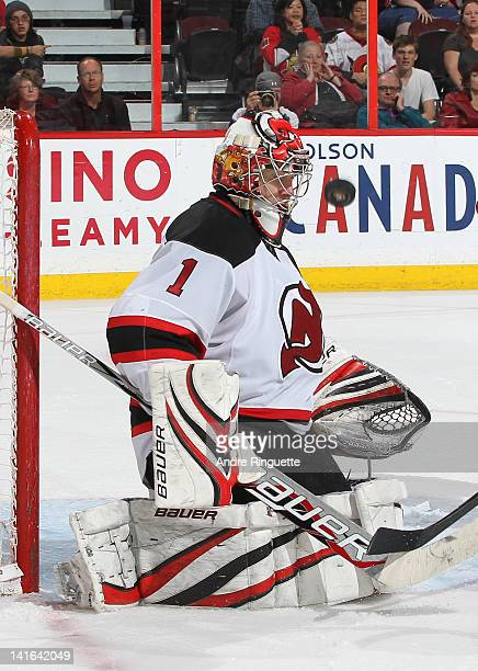 Johan Hedberg of the New Jersey Devils makes a save during his shutout win against the Ottawa Senators at Scotiabank Place on March 20 2012 in Ottawa...