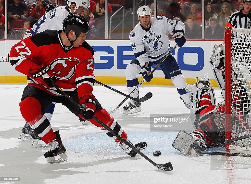 <a gi-track='captionPersonalityLinkClicked' href=/galleries/search?phrase=Johan+Hedberg&family=editorial&specificpeople=202078 ng-click='$event.stopPropagation()'>Johan Hedberg</a> #1 of the New Jersey Devils makes a sprawling pad save as Krystofer Barch #22 looks to clear the puck against the Tampa Bay Lightning during the game at the Prudential Center on March 5, 2013 in Newark, New Jersey.