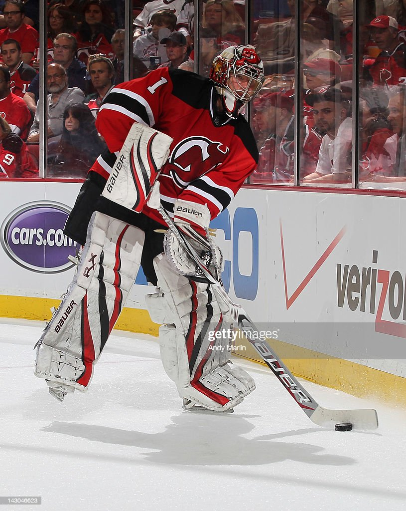 Johan Hedberg of the New Jersey Devils plays the puck against the Florida Panthers in Game Three of the Eastern Conference Quarterfinals during the...