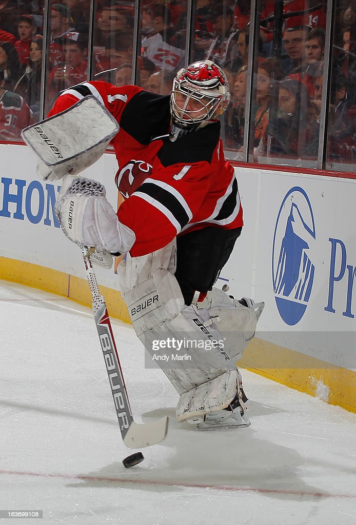 Johan Hedberg #1 of the New Jersey Devils plays the puck against the Philadelphia Flyers during the game at the Prudential Center on March 13, 2013 in Newark, New Jersey.