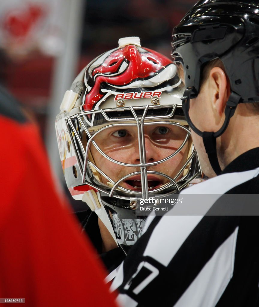 Johan Hedberg #1 of the New Jersey Devils speaks with the referee during the game against the Philadelphia Flyers at the Prudential Center on March 13, 2013 in Newark, New Jersey. The Devils defeated the Flyers 5-2.