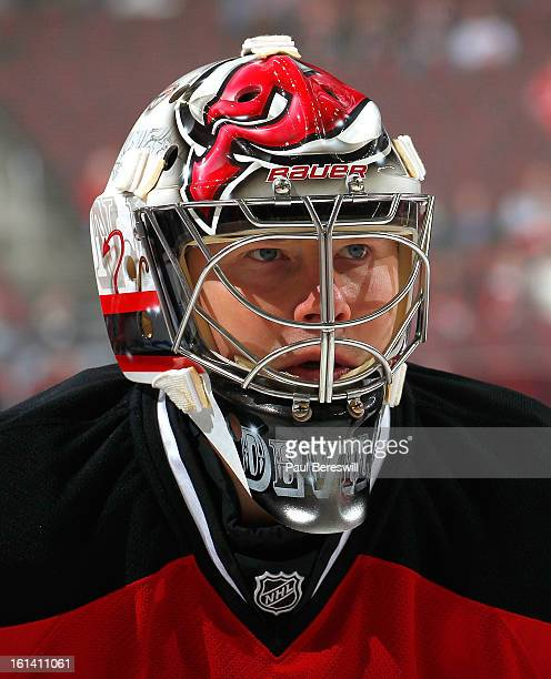Johan Hedberg of the New Jersey Devils stares during warmups before an NHL hockey game against the New York Rangers at Prudential Center on February...