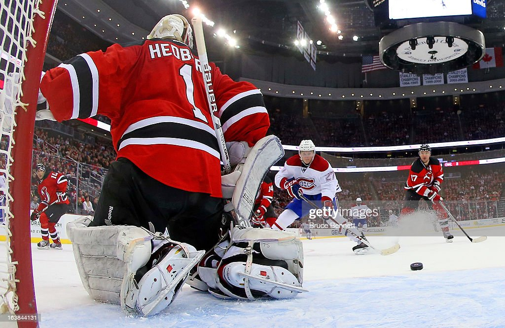 Johan Hedberg #1 of the New Jersey Devils stops a shot by Alex Galchenyuk #27 of the Montreal Canadiens at the Prudential Center on March 16, 2013 in Newark, New Jersey. The Canadiens defeated the Devils 2-1.