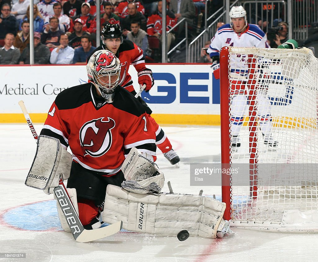 Johan Hedberg #1 of the New Jersey Devils stops a shot in the third period against the New York Rangers at the Prudential Center on March 19, 2013 in Newark, New Jersey. The New York Rangers defeated the New Jersey Devils 3-2.