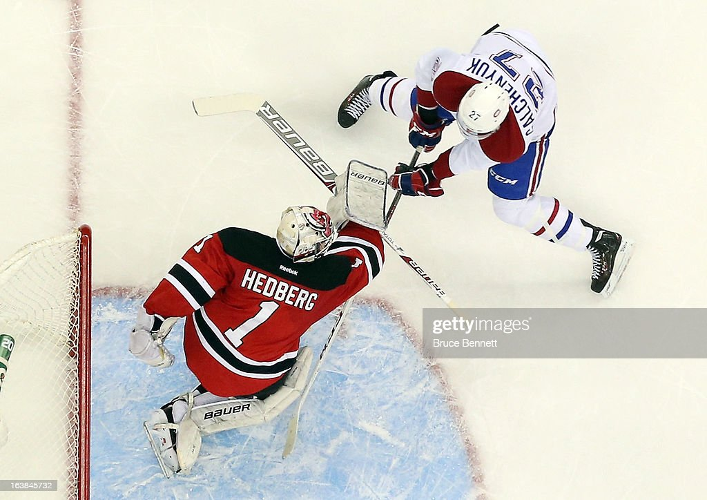 <a gi-track='captionPersonalityLinkClicked' href=/galleries/search?phrase=Johan+Hedberg&family=editorial&specificpeople=202078 ng-click='$event.stopPropagation()'>Johan Hedberg</a> #1 of the New Jersey Devils stops <a gi-track='captionPersonalityLinkClicked' href=/galleries/search?phrase=Alex+Galchenyuk&family=editorial&specificpeople=7419137 ng-click='$event.stopPropagation()'>Alex Galchenyuk</a> #27 of the Montreal Canadiens at the Prudential Center on March 16, 2013 in Newark, New Jersey. The Canadiens defeated the Devils 2-1.