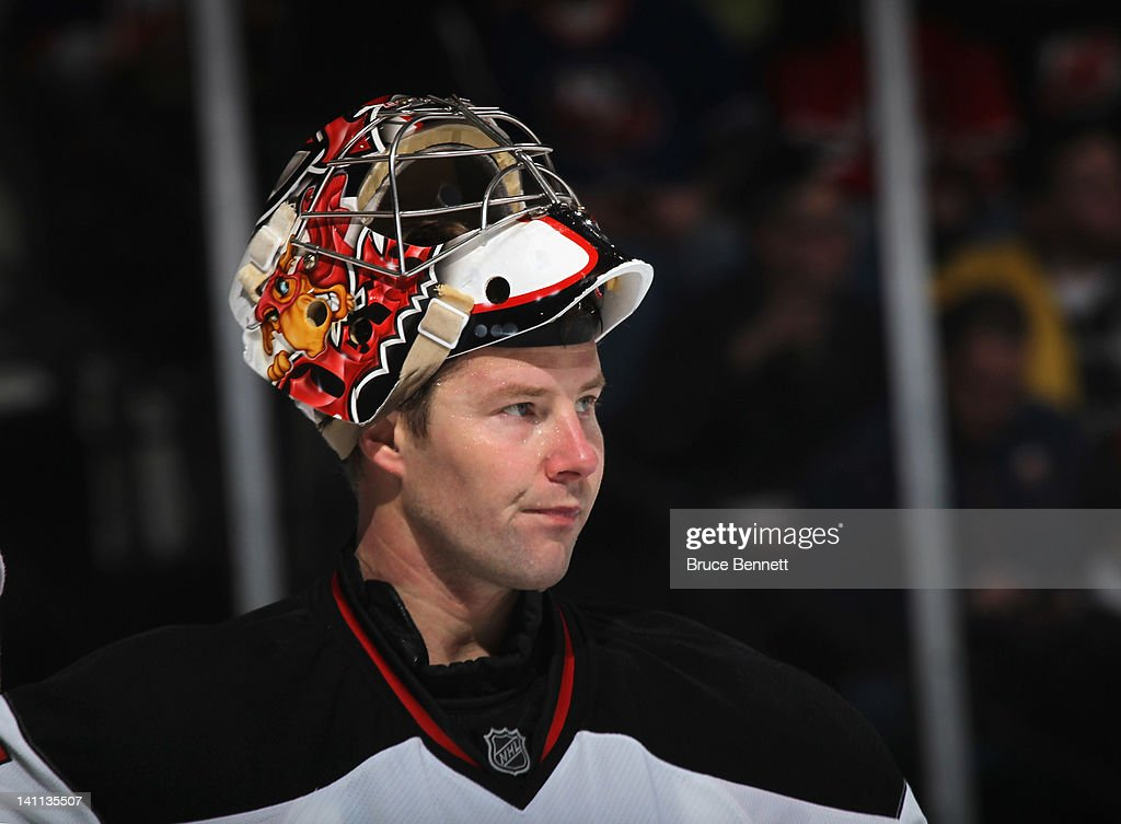 <a gi-track='captionPersonalityLinkClicked' href=/galleries/search?phrase=Johan+Hedberg&family=editorial&specificpeople=202078 ng-click='$event.stopPropagation()'>Johan Hedberg</a> #1 of the New Jersey Devils takes a break during his game against the New York Islanders at the Nassau Veterans Memorial Coliseum on March 10, 2012 in Uniondale, New York.