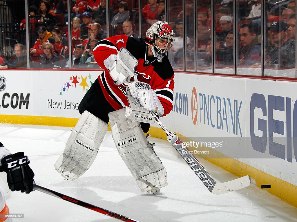 Johan Hedberg #1 of the New Jersey Devils tends net against the Philadelphia Flyers at the Prudential Center on March 13, 2013 in Newark, New Jersey. The Devils defeated the Flyers 5-2.