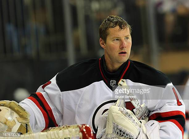 Johan Hedberg of the New Jersey Devils waits for play to begin against the New York Rangers at Madison Square Garden on April 27 2013 in New York...
