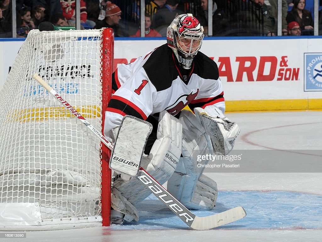 Johan Hedberg #1 of the New Jersey Devils watches the game action as he tends goal during the game against the New York Islanders on February 3, 2013 at Nassau Veterans Memorial Coliseum in Uniondale, New York.