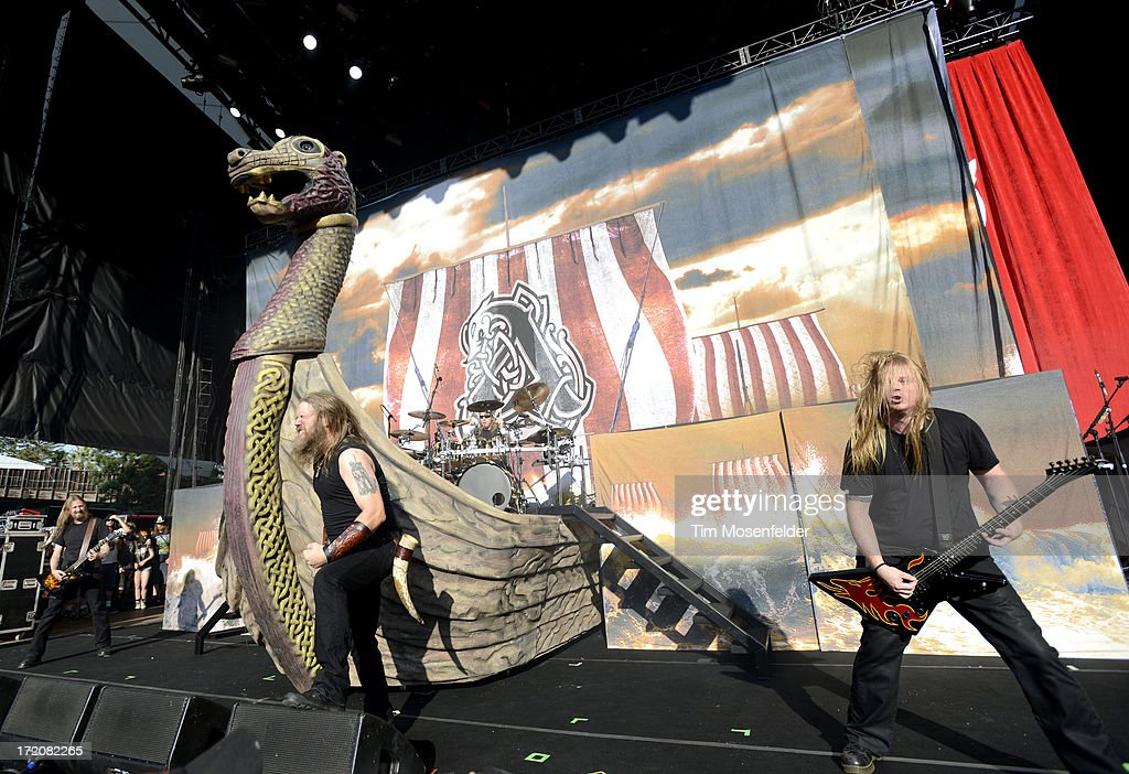 <a gi-track='captionPersonalityLinkClicked' href=/galleries/search?phrase=Johan+Hegg&family=editorial&specificpeople=5400863 ng-click='$event.stopPropagation()'>Johan Hegg</a> (C) and Amon Amarth perform as part of the Rockstar Energy Drink Mayhem Festival at Shoreline Amphitheatre on June 30, 2013 in Mountain View, California.