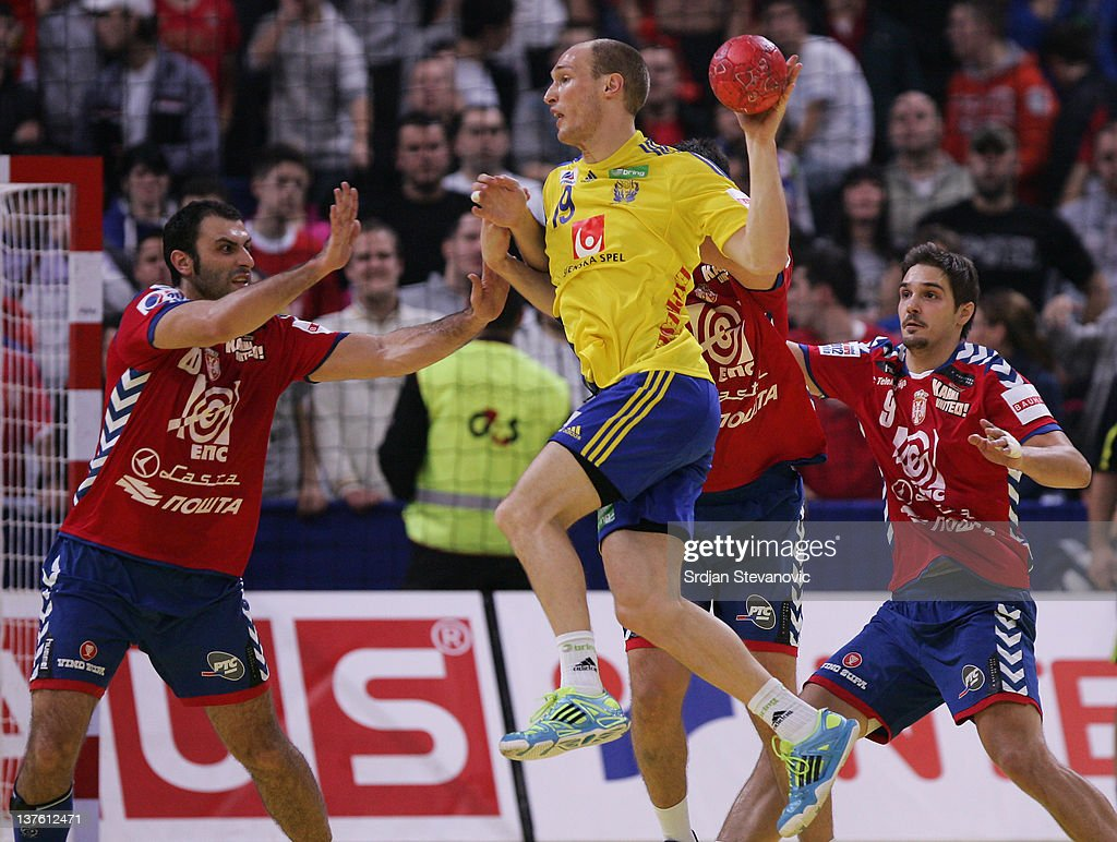 Johan Jakobsson (C) of Sweden in action with Ivan Stankovic (L) and Nikola Manojlovic (R) of Serbia during the Men's European Handball Championship 2012 second round group one match between Serbia and Sweden at Arena Hall on January 23, 2012 in Belgrade, Serbia.