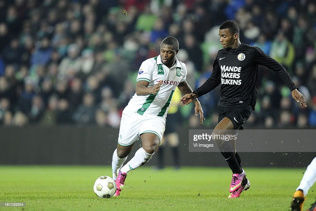 Johan Kappelhof of FC Groningen, Cuco Martina of RKC Waalwijk, during the Dutch Eredivisie match between FC Groningen and RKC Waalwijk at the Euroborg on february 9, 2013 in Groningen, The Netherlands