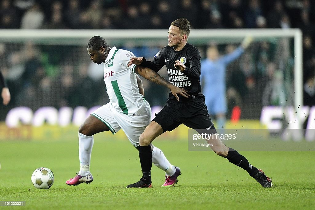 Johan Kappelhof of FC Groningen, Frank van Mosselveld of RKC Waalwijk, during the Dutch Eredivisie match between FC Groningen and RKC Waalwijk at the Euroborg on february 9, 2013 in Groningen, The Netherlands