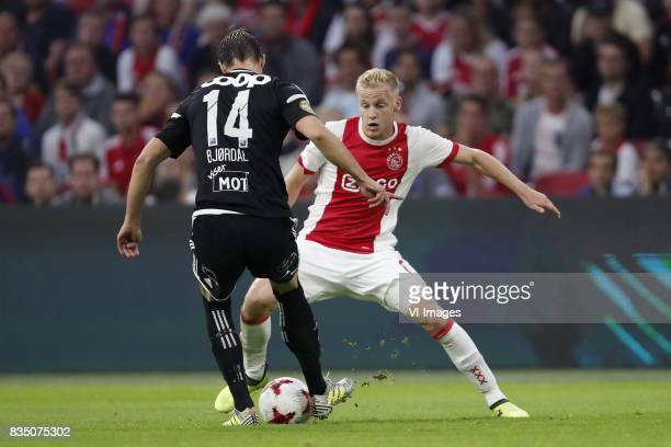 Johan Laedre Bjordal of Rosenborg BK Donny van de Beek of Ajax during the UEFA Europa League fourth round qualifying first leg match between Ajax...