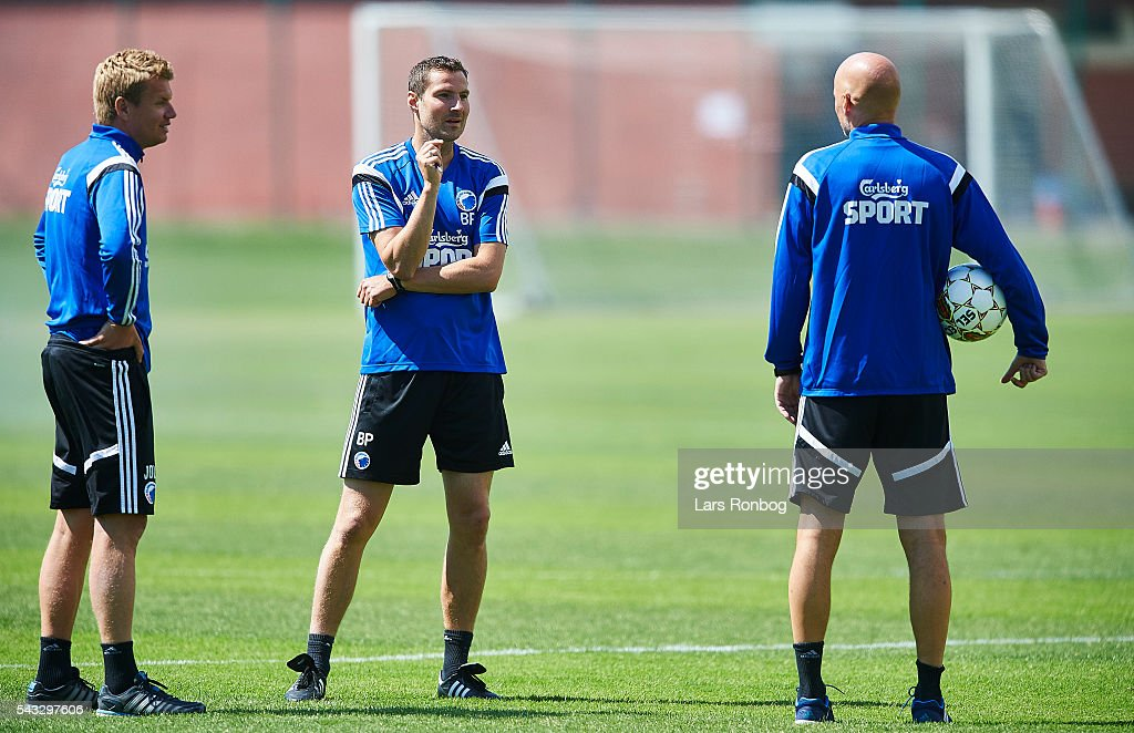 Johan Lange, Brian Priske, assistant coach of FC Copenhagen and <a gi-track='captionPersonalityLinkClicked' href=/galleries/search?phrase=Stale+Solbakken&family=editorial&specificpeople=2726325 ng-click='$event.stopPropagation()'>Stale Solbakken</a>, head coach of FC Copenhagen talking during the FC Copenhagen training session at KB's baner on June 27, 2016 in Frederiksberg, Denmark.