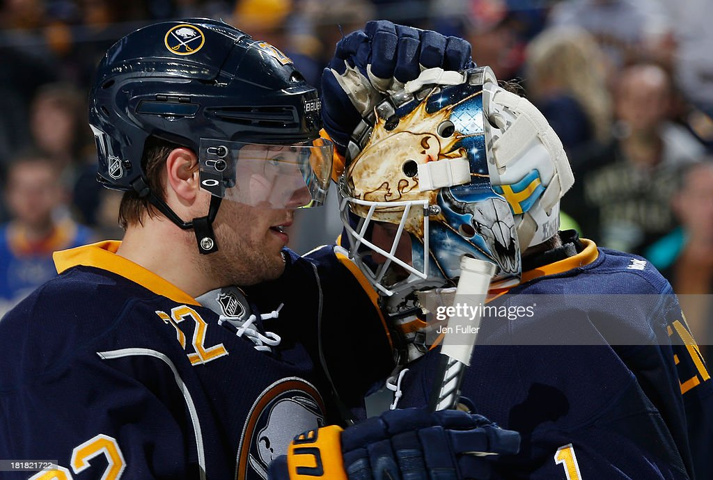 Johan Larsson #22 and <a gi-track='captionPersonalityLinkClicked' href=/galleries/search?phrase=Jhonas+Enroth&family=editorial&specificpeople=570456 ng-click='$event.stopPropagation()'>Jhonas Enroth</a> #1 of the Buffalo Sabres celebrate their 3-0 preseason win over the Columbus Blue Jackets at First Niagara Center on September 25, 2013 in Buffalo, New York.