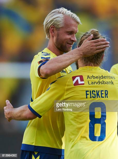Johan Larsson and Kasper Fisker of Brondby IF celebrate after scoring their second goal during the UEFA Europa League Qualification match between...