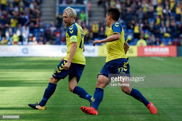 Johan Larsson and Svenn Crone of Brondby IF celebrate after scoring their first goal during the Danish Alka Superliga match between Brondby IF and AC...