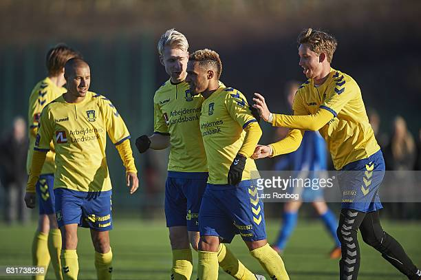 Johan Larsson Hany Mukhtar and Goalkeeper Frederik Ronnow of Brondby IF celebrate during the preseason friendly match between Brondby IF and KFUM...