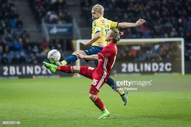 Johan Larsson of Brondby IF and Jeppe Kjar of Lyngby BK the Danish Alka Superliga match between Brondby IF and Lyngby BK at Brondby Stadion on March...