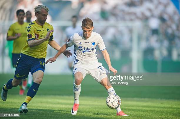 Johan Larsson of Brondby IF and Kasper Kusk of FC Copenhagen compete for the ball during the Danish Alka Superliga match between FC Copenhagen and...