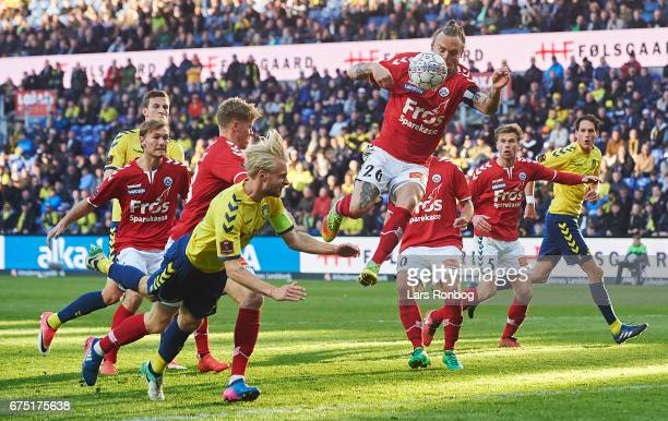 Johan Larsson of Brondby IF and Pierre Kanstrup of Sonderjyske in action during the Danish Alka Superliga match between Brondby IF and Sondejryske at...