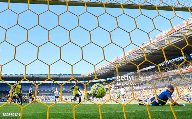 Johan Larsson of Brondby IF scores the 10 goal against Goalkeeper Jesse Joronen of AC Horsens during the Danish Alka Superliga match between Brondby...