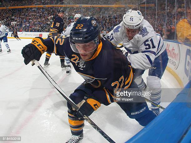 Johan Larsson of the Buffalo Sabres battles for the puck against Jake Gardiner of the Toronto Maple Leafs during an NHL game on March 31 2016 at the...