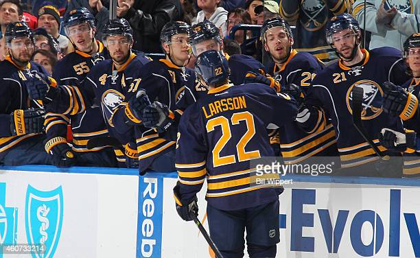 Johan Larsson of the Buffalo Sabres celebrates after scoring his first career NHL goal against the Colorado Avalanche on December 20 2014 at the...
