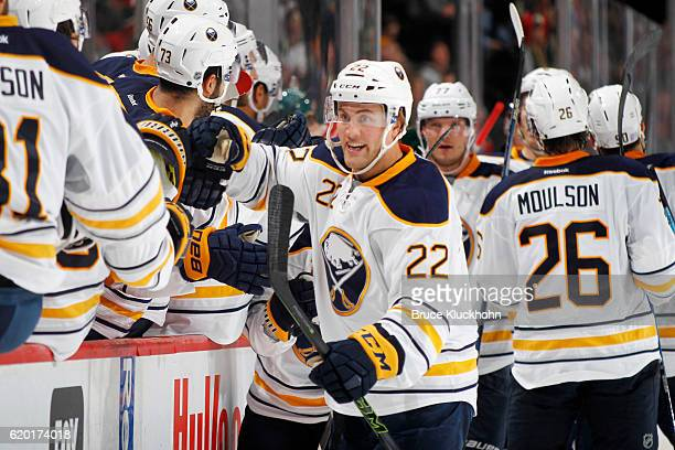 Johan Larsson of the Buffalo Sabres celebrates after scoring the game winning goal against the Minnesota Wild during the game on November 1 2016 at...