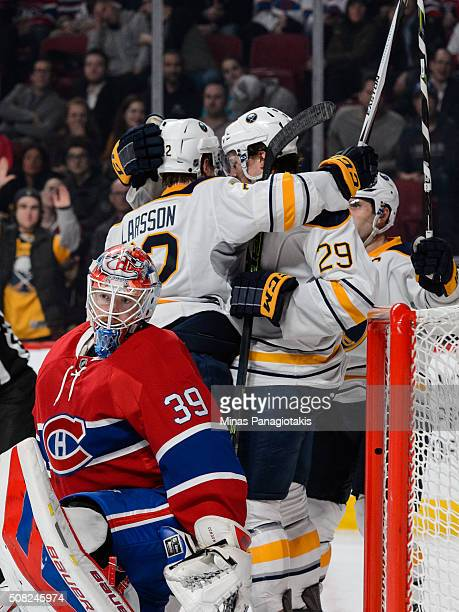 Johan Larsson of the Buffalo Sabres celebrates his goal with teammates near goaltender Mike Condon of the Montreal Canadiens during the NHL game at...