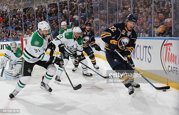 Johan Larsson of the Buffalo Sabres controls the puck in front of Tyler Seguin and Alex Golgoski of the Dallas Stars during an NHL game on November...