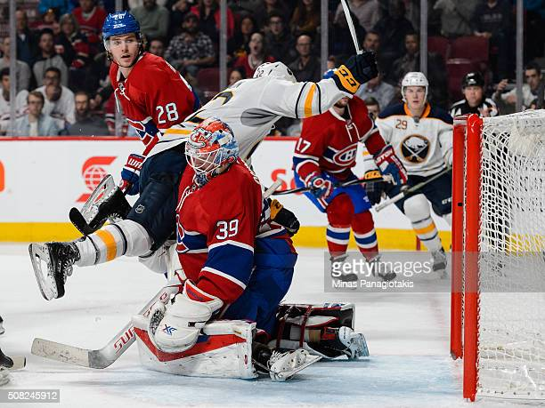 Johan Larsson of the Buffalo Sabres scores on goaltender Mike Condon of the Montreal Canadiens during the NHL game at the Bell Centre on February 3...