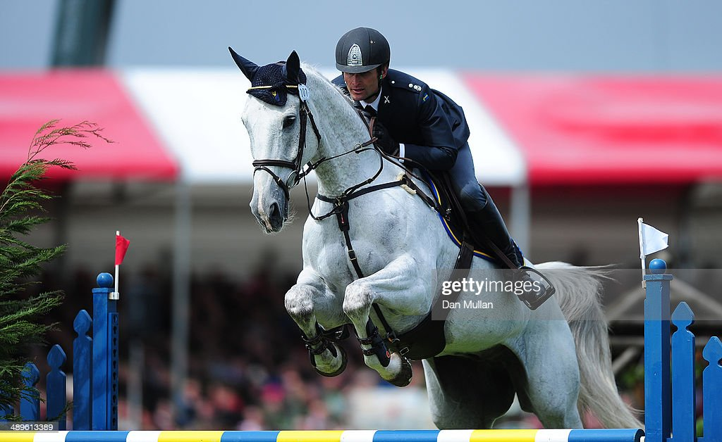 Johan Lundin of Sweden riding Johnny Cash during the Show Jumping on day five of the Badminton Horse Trials on May 11, 2014 in Badminton, England.